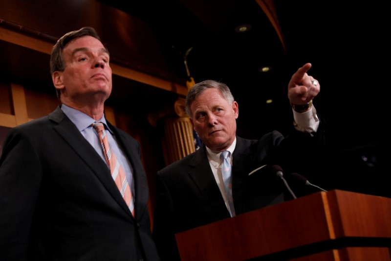 Senate Intelligence Committee Chairman Sen. Richard Burr, accompanied bу Senator Mark Warner, vice chairman of the committee, speaks at a news conference to discuss their probe of Russian interference in the 2016 election on Capitol Hill in Washington