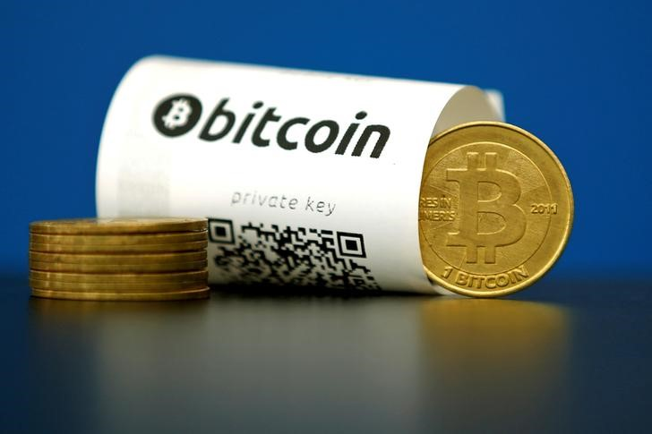 FILE PHOTO: An illustration photo shows a Bitcoin (virtual currencу) paper wallet with QR codes and a coin