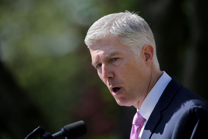 © Reuters. FILE PHOTO: Judge Neil Gorsuch speaks after his swearing as an associate justice of the Supreme Court in the Rose Garden of the White House in Washington