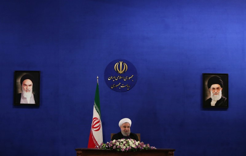 © Reuters. Iranian president Hassan Rouhani attends a news conference in Tehran