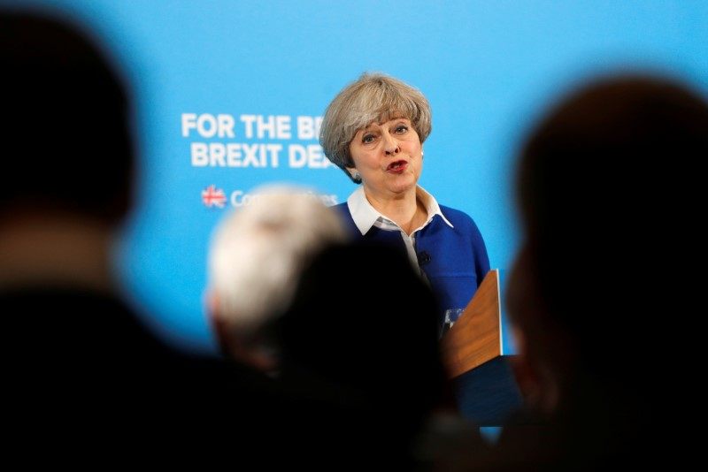British PM May calls on BA to fix I.T. system, compensate customers