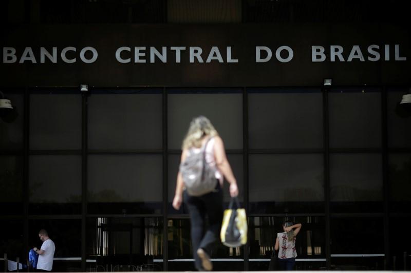 Brazil slashes rates, but signals dial down amid political storm