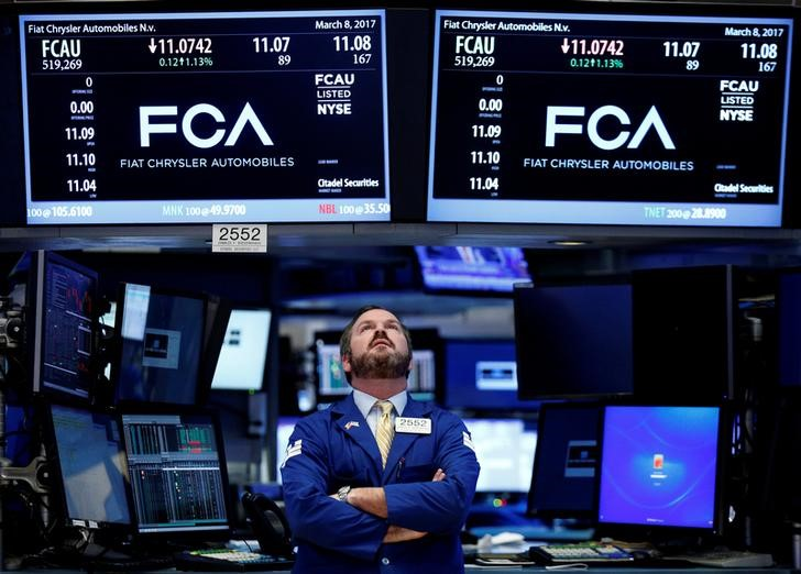 © Reuters. A specialist trader works at the post where Fiat Chrysler Automobiles is traded on the floorof the NYSE