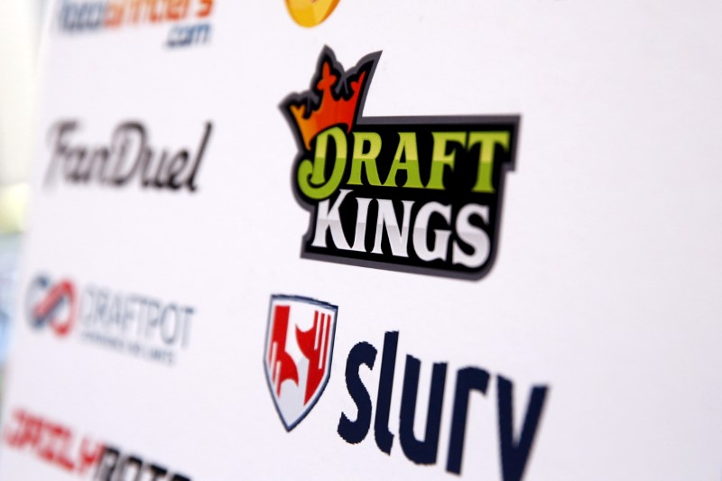 © Reuters. A DraftKings logo is displayed on a board inside of the DFS Players Conference in New York