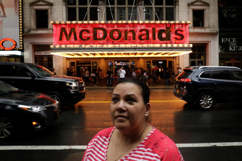 © Reuters. Flavia Cabral, a McDonald's employee, poses for a portrait in New York City