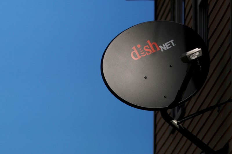 © Reuters. FILE PHOTO: A Dish Network receiver hangs on a house in Somerville