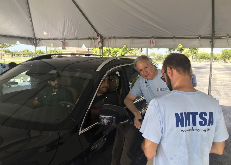© Reuters. NHTSA staff talk to a motorist getting a safety check at Florida International University in Miami, Florida