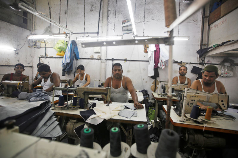 © Reuters. Employees work inside a garment factory at an industrial area in Mumbai