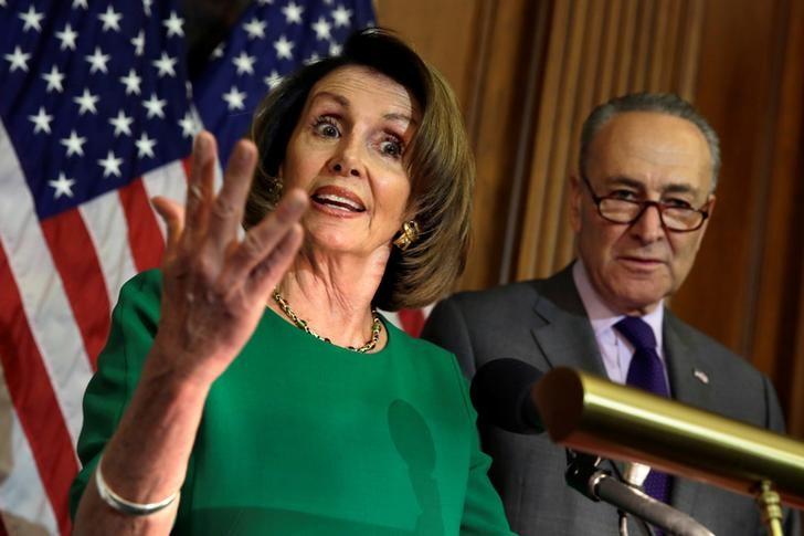 © Reuters. House Minority Leader Nancy Pelosi (D-CA) speaks next to Senate Minority Leader Chuck Schumer (D-NY)