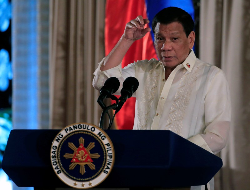 © Reuters. Duterte gestures as he delivers his speech during the oath taking of PNP star rank officers in Manila