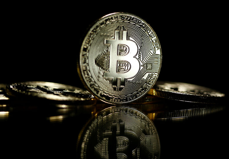 © Reuters. Bitcoins are seen in this illustration picture