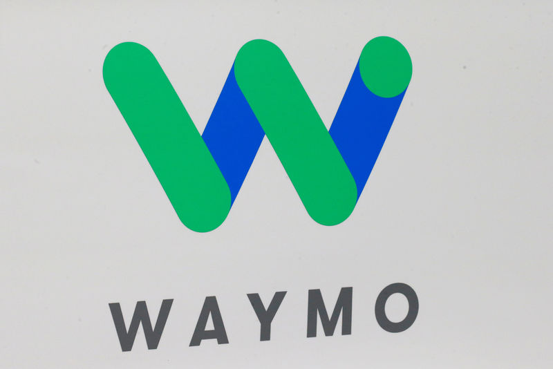 © Reuters. FILE PHOTO: The Waymo logo is displayed during the company's unveil of a self-driving Chrysler Pacifica minivan during the North American International Auto Show in Detroit