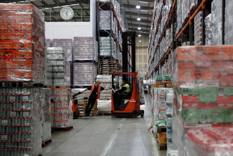 © Reuters. Men work at Grace Foods UK distribution centre in Welwyn Garden City