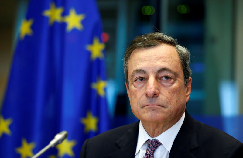 © Reuters. ECB President Draghi arrives to address the EU Parliament's Economic and Monetary Affairs Committee in Brussels