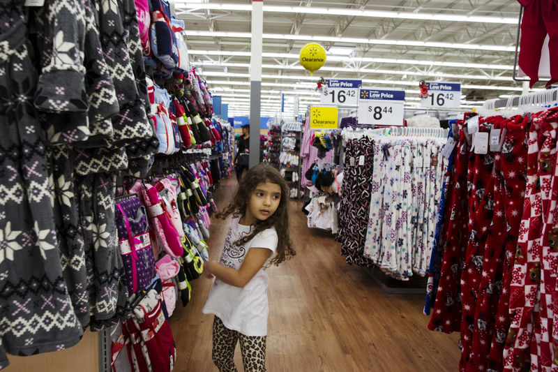 © Reuters. FILE PHOTO: A girl looks at pajamas while shopping at a Walmart store in Secaucus, New Jersey