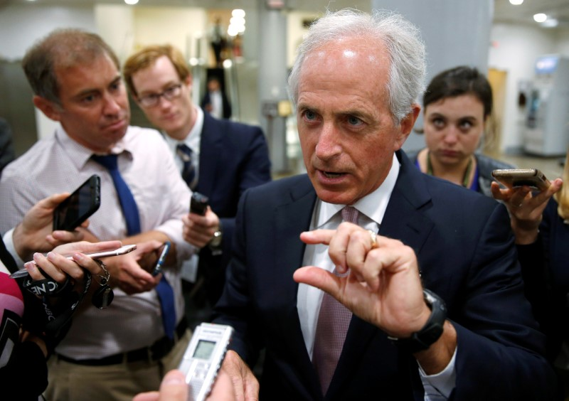 © Reuters. Senator Bob Corker (R-TN) speaks to reporters after the Senate approved $15.25 billion in aid for areas affected by Hurricane Harvey in Washington