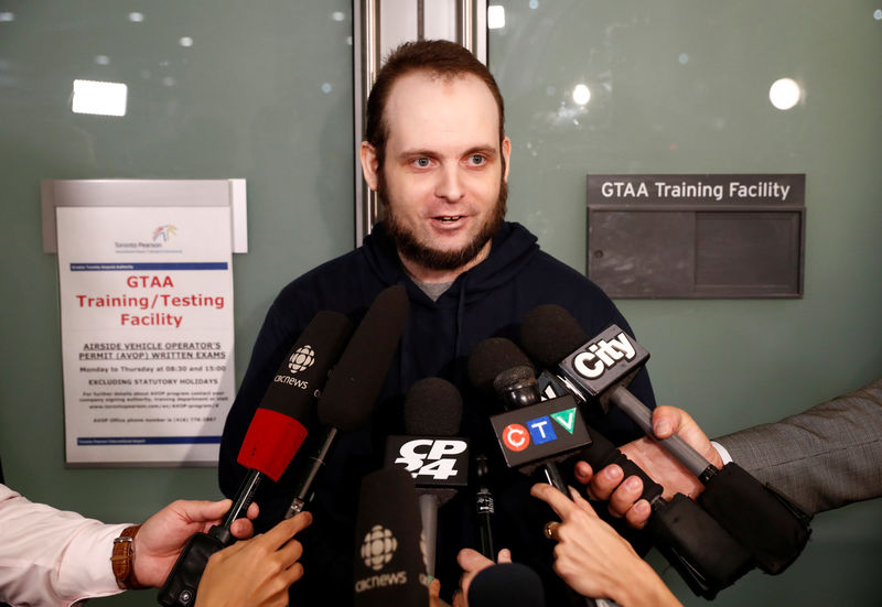© Reuters. Boyle speaks to the media after arriving at Toronto Pearson International Airport, nearly 5 years after he and his wife were abducted in Afghanistan in 2012, in Toronto