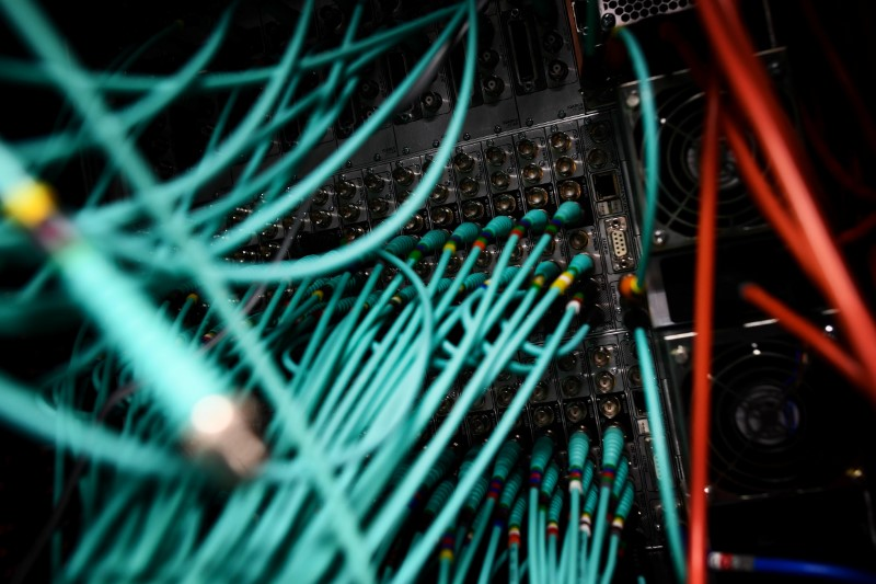 © Reuters. Cables and computers are seen inside a data centre at an office in the heart of the financial district in London
