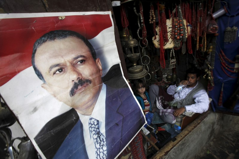 © Reuters. A poster of Saleh is seen on a door of a shop in an old quarter of Yemen's capital Sanaa