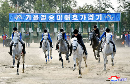 © Reuters. People take part in a horse riding game at the Mirim Equestrian Riding Club in Pyongyang