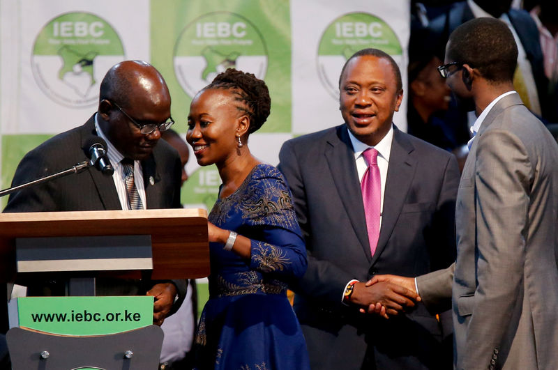 © Reuters. File Photo: Kenyan Independent Electoral and Boundaries Commission commissioner Roselyn Akombe talks to the IEBC chairman Wafula Chebukati at the Bomas of Kenya, in Nairobi