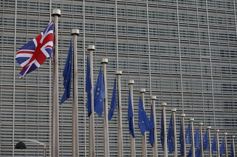 © Reuters. A Union Jack flag flutters next to European Union flags ahead of a visit of Britain's Prime Minister Theresa May and Britain's Secretary of State for Exiting the European Union David Davis at the European Commission headquarters in Brussels