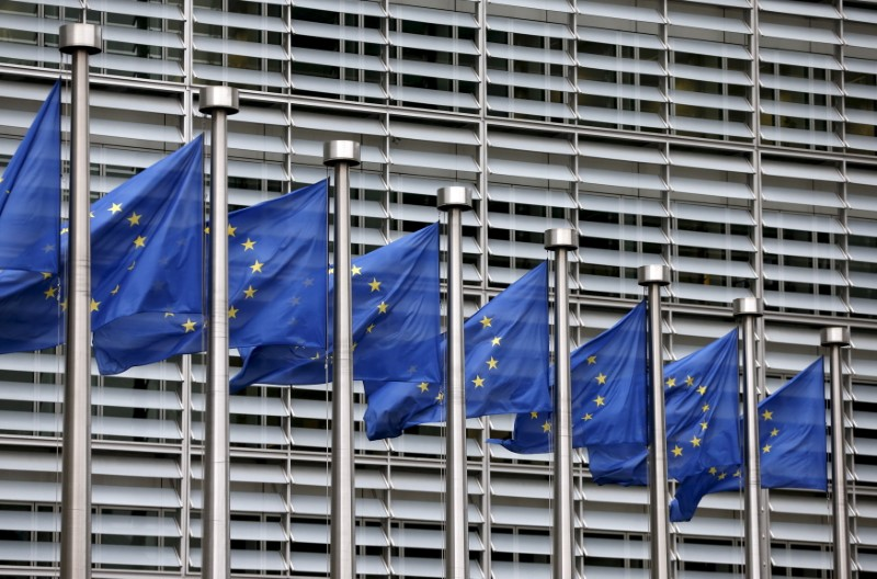 © Reuters. File picture shows European Union flags fluttering outside the EU Commission headquarters in Brussels