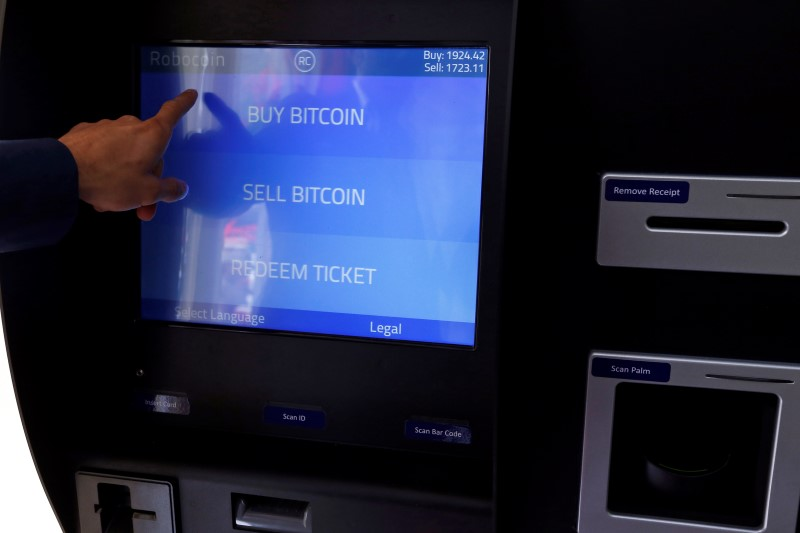 © Reuters. Romania's first bitcoin ATM is seen in downtown Bucharest