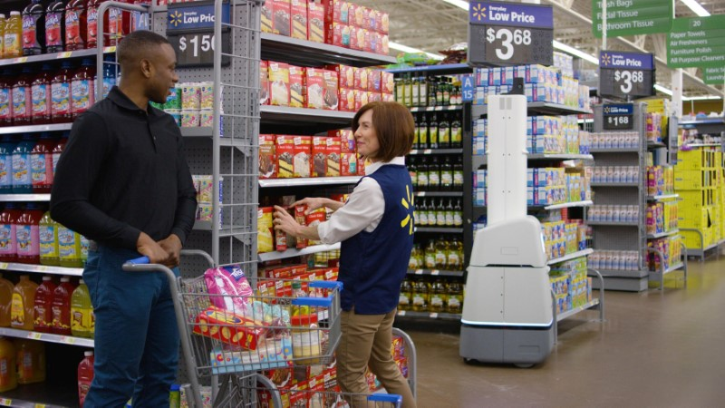© Reuters. Wal-Mart Stores Inc's shelf-scanning robots replenish inventory to save employees time when products run out as seen in this handout photo