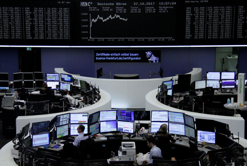 European shares open flat as earning roll in, Spain rebounds