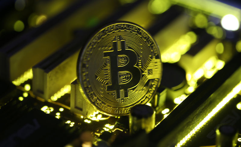 © Reuters. A copy of bitcoin standing on PC motherboard is seen in this illustration picture