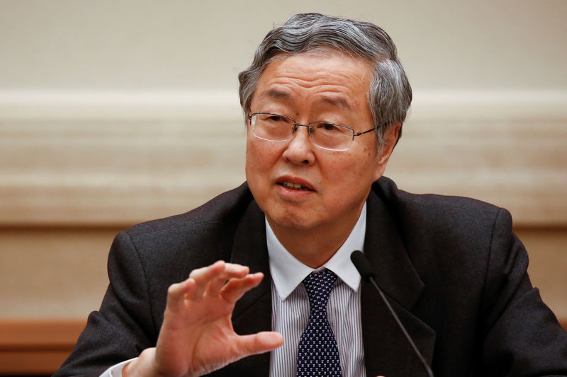 © Reuters. China's central bank governor Zhou Xiaochuan speaks during a session on the second day of the 19th National Congress of the Communist Party of China at the Great Hall of the People in Beijing