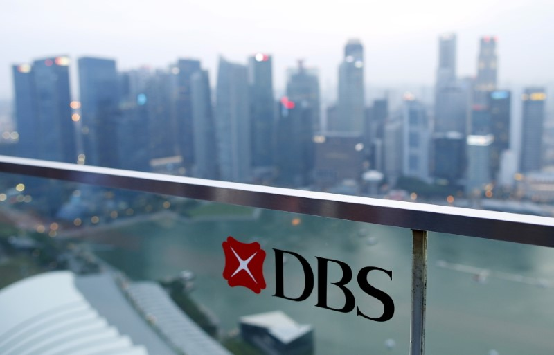 © Reuters. A DBS logo in pictured in the backdrop of the central business district in Singapore