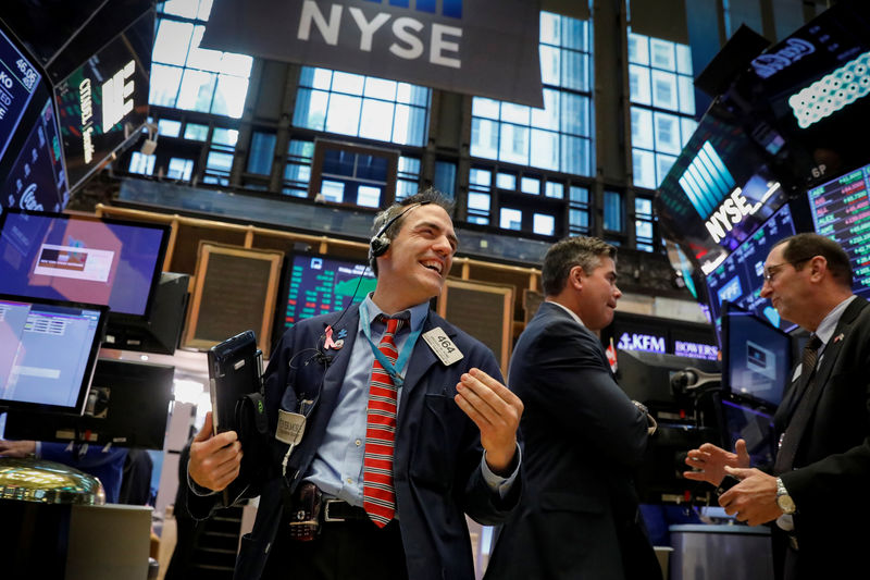 Dow edges up to record high, financials dips