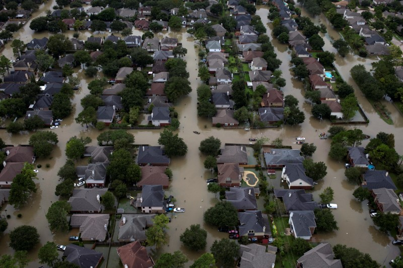 © Reuters. FILE PHOTO: Houses are seen submerged in flood waters caused by Tropical Storm Harvey in Houston