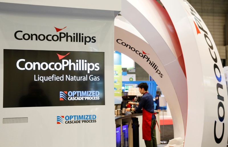 © Reuters. Logos of ConocoPhillips are seen in its booth at Gastech, the world's biggest expo for the gas industry, in Chiba