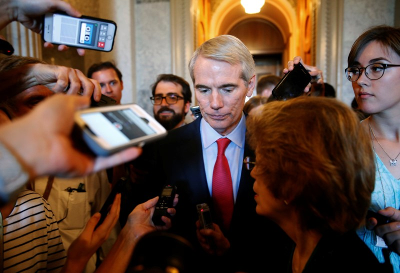 © Reuters. Senator Rob Portman (R-OH) speaks to reporters about the Senate healthcare bill on Capitol Hill in Washington