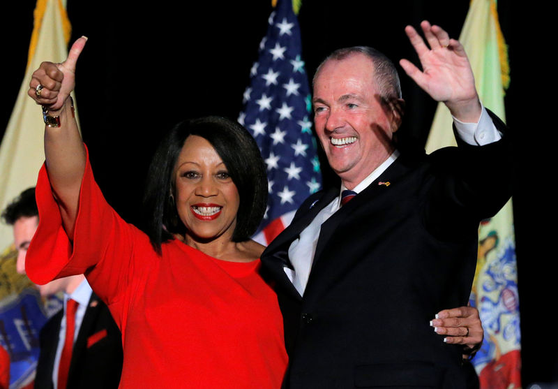 © Reuters. FILE PHOTO: Murphy and Oliver celebrate after being elected Governor of New Jersey in Asbury Park