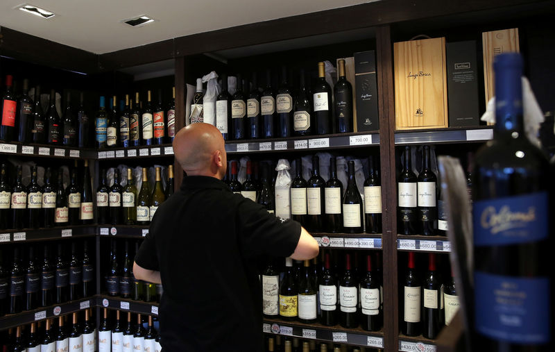 © Reuters. A man works inside a wine store in Buenos Aires
