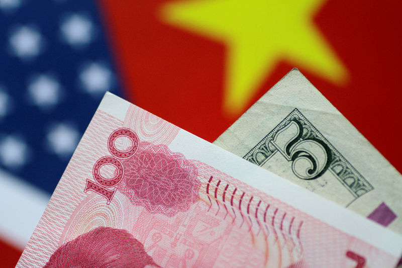 © Reuters. FILE PHOTO: Illustration photo of U.S. Dollar and China Yuan notes