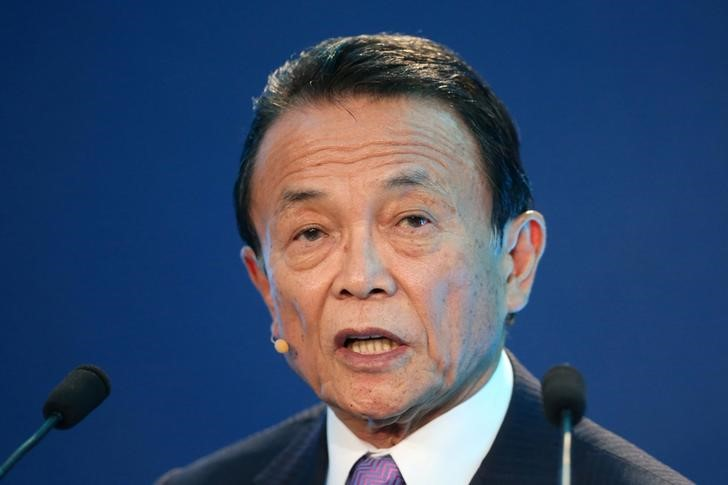 © Reuters. FILE PHOTO: Taro Aso, Deputy Prime Minister, Minister of Finance and Minister of State for Financial Services of Japan, speaks during the Milken Institute Global Conference in Beverly Hills