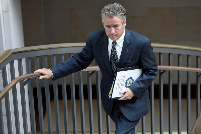 © Reuters. FILE PHOTO: Senator Rand Paul (R-KY) departs after a briefing on Capitol Hill in Washington