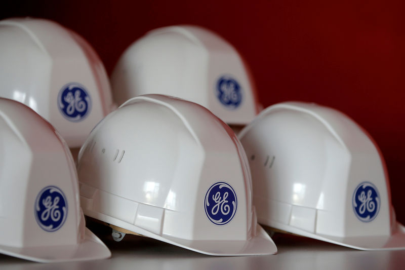 © Reuters. FILE PHOTO: The General Electric logo is pictured on working helmets during a visit at the General Electric offshore wind turbine plant in Montoir-de-Bretagne