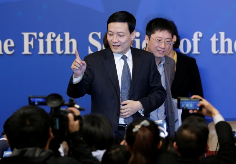 © Reuters. FILE PHOTO: The director of China's state assets regulator Xiao Yaqing speaks to the media in Beijing
