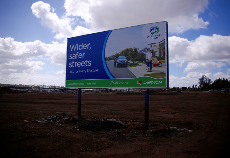 © Reuters. A promotional sign is displayed at a new housing development in the western Sydney suburb of Oran Park in Australia