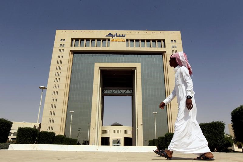 © Reuters. A man walks past the headquarters of Saudi Basic Industries Corp (SABIC) in Riyadh