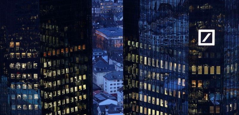 © Reuters. FILE PHOTO: The headquarters of Germany's Deutsche Bank are seen early evening in Frankfurt
