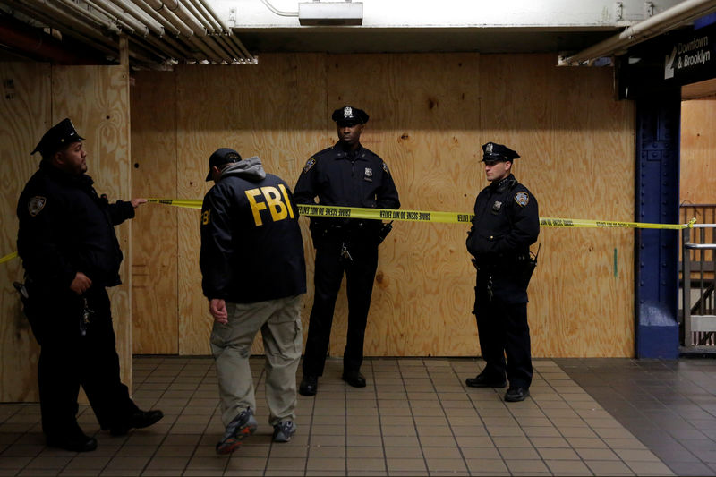 © Reuters. A member of the FBI enters the crime scene beneath the New York Port Authority Bus Terminal following an attempted detonation during the morning rush hour, in New York City