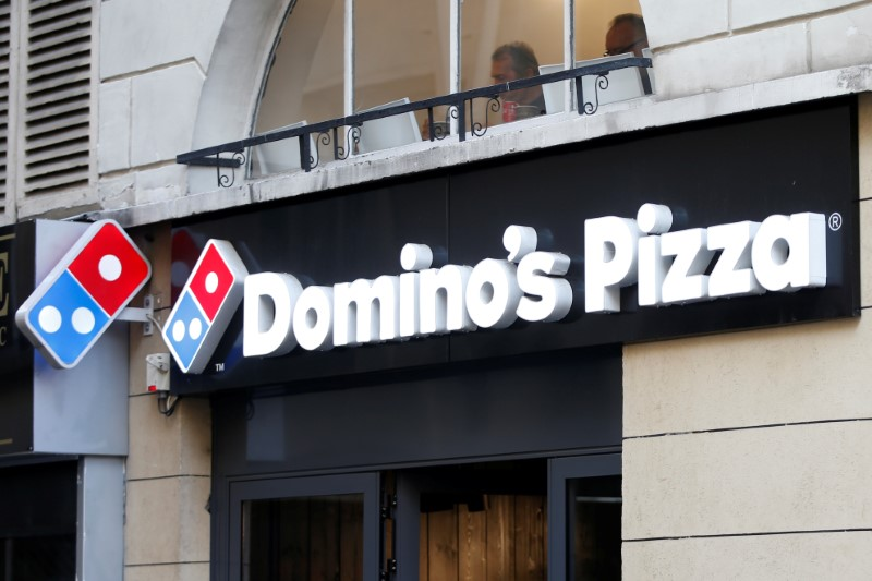 © Reuters. The sign of a Domino's Pizza restaurant is seen in Paris