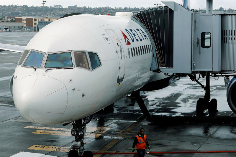 © Reuters. FILE PHOTO: A Delta Airlines plane is seen at a gate in San Diego